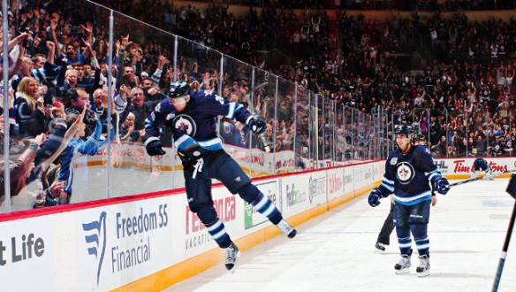 Jets player checking imaginary opponent hard into the glass, to the delight of all